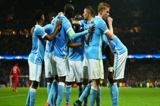 MANCHESTER, ENGLAND - OCTOBER 21:  Kevin De Bruyne of Manchester City celebrates scoring his team's second goal with team mates during the UEFA Champions League Group D match between Manchester City and Sevilla at Etihad Stadium on October 21, 2015 in Manchester, United Kingdom.  (Photo by Richard Heathcote/Getty Images)